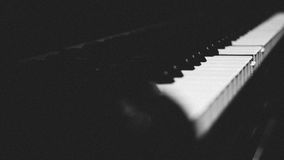 Piano keys on black classical grand piano. Play a classic song royalty free stock photography
