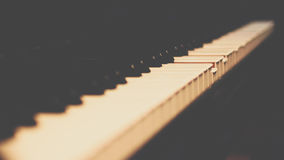 Piano keys on black classical grand piano. Play a classic song stock images