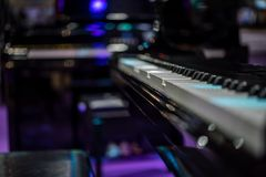 Piano keys on black classical grand piano. Play a classic song stock photography
