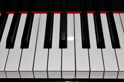 Piano keys. Piano Black and white keys on a acoustic stock photography