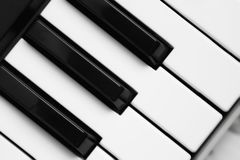 Piano keys black and white image. vintage style background. Piano keys black and white image royalty free stock photo