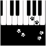 Piano keys with cat footprints Royalty Free Stock Images