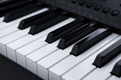 Piano keys close-up. Black and white keys of the piano closeup Stock Images
