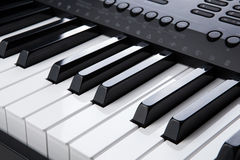Piano keys close-up. Black and white keys of the piano closeup Stock Image