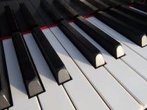 Piano keys. Close-up of piano keys. close frontal view stock photography