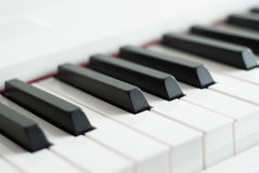 Piano keys close-up. Piano playing. Black and white keys. Electronic piano Stock Images