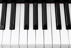 Piano keys closeup Stock Images