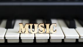 Piano keys closeup with the letters music. Object Stock Photography
