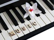 Piano keys closeup with the letters music. Object Royalty Free Stock Photography
