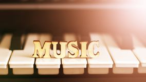 Piano keys closeup with the letters music. Object Stock Images