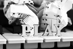 Piano keys closeup with the letters play. Object Stock Images