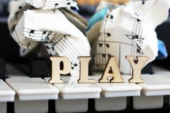 Piano keys closeup with the letters play. Object Royalty Free Stock Photo