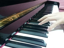 Piano keys with finger playing in music lesson Stock Photography