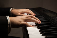 Piano keys and human hands Royalty Free Stock Photos