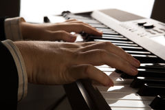 Piano keys and human hands Stock Images