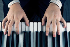 Piano keys and human hands Royalty Free Stock Image