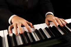 Piano keys and human hands Royalty Free Stock Photography