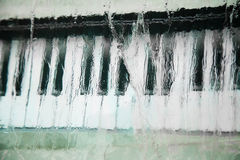 Piano keys into the ice. Piano keys frozen into the ice. Close-up Stock Photo
