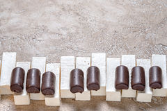 Piano keys laid out chocolates candy Royalty Free Stock Photo