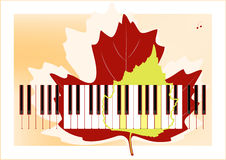 Piano keys and leaves Royalty Free Stock Image