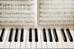 Piano keys and music book Stock Photos