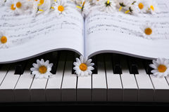 Piano keys and musical book and flower Royalty Free Stock Photos