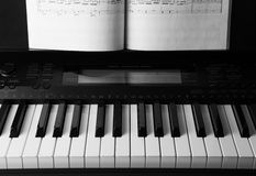 Piano keys and musical book Stock Photo