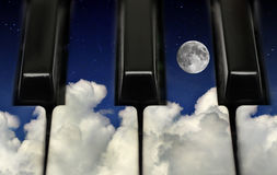 Piano keys and night sky. Piano keys with full moon night sky background stock images