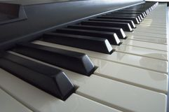 Piano Keys in Perspective. Perspective view of the 88 high polish keys of a piano Stock Images