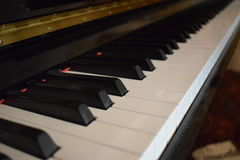 Piano keys. Picutre of piano  and close up of the keys Stock Image