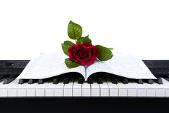 Piano keys and rose flower on note book Stock Photography