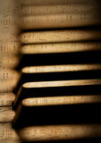 Piano keys and sheet music Stock Photos