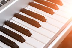 Piano keys, synth closeup, background, toned. Keys electric pianos or synth closeup toned Royalty Free Stock Photos