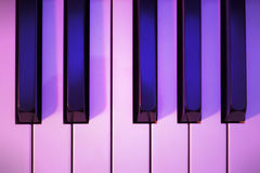 Piano Keys Under Colored Lighting. One Octave of Piano Keys Photographed Under Colored Lighting Royalty Free Stock Image