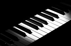 Piano keys under spotlight Stock Images
