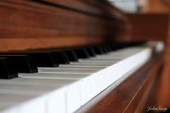 Piano keys. View of piano keys from the side Royalty Free Stock Photography