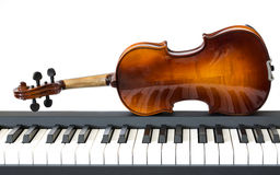 Piano keys and violin Royalty Free Stock Photography