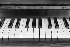 Piano keys and wood grain Stock Images