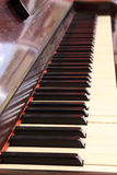 Piano keys and wood grain Royalty Free Stock Photography