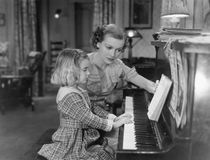 Piano lesson. (All persons depicted are no longer living and no estate exists. Supplier grants that there will be no model release issues Royalty Free Stock Images
