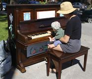 Piano lesson. This summer, Montreal City put pianos in Montreal parks. Everybody can play Stock Image