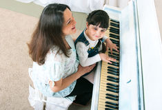 Piano Lessons - Mother and Daughter Stock Photo