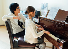 Piano lessons at  music school Stock Images