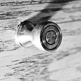 Piano lid knob. On a wooden lid Stock Images