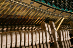 The piano mechanism. Mechanism of fortepiano from within at play Royalty Free Stock Image