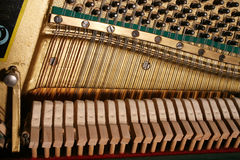 The piano mechanism. Mechanism inside of old fortepiano Stock Images