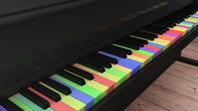 Piano med differntly kulöra tangenter på trägolv Fotografering för Bildbyråer
