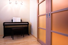 Piano in modern room Stock Photos