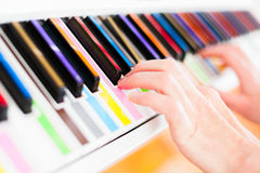 Piano with multy colour keys. Close up Stock Images