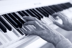 Piano with multy colour keys. Close up Royalty Free Stock Photo